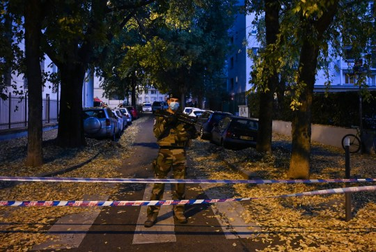 A French soldier stands behind a cordon in Lyon near the scene where an attacker armed with a sawn-off shotgun wounded an Orthodox priest