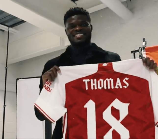 Thomas Partey poses with Arsenal shirt after transfer move