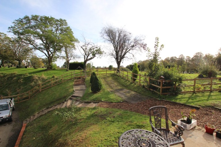 gatehouse with its own turret for sale - gardens