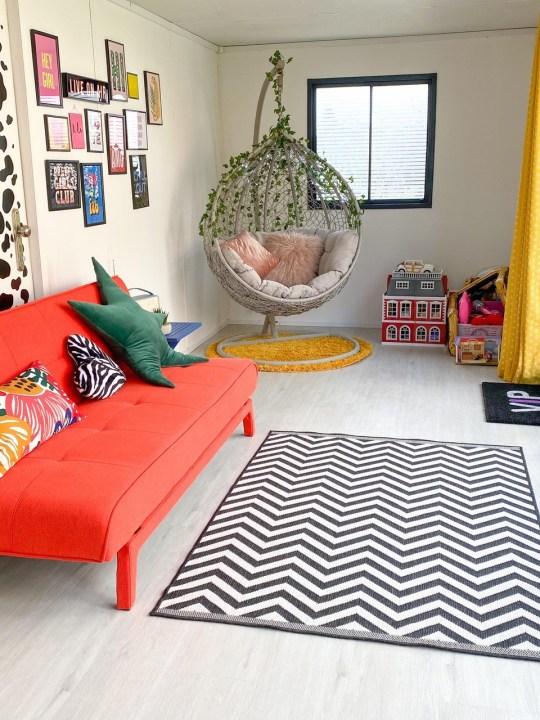 the zen den garden cabin interiors with sofa and hanging egg chair