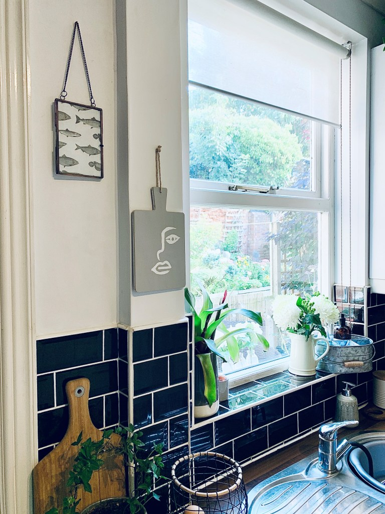 What I Rent: Vikki, £625 for a two-bedroom flat in Derby - painted chopping board and fish print hanging on wall of kitchen