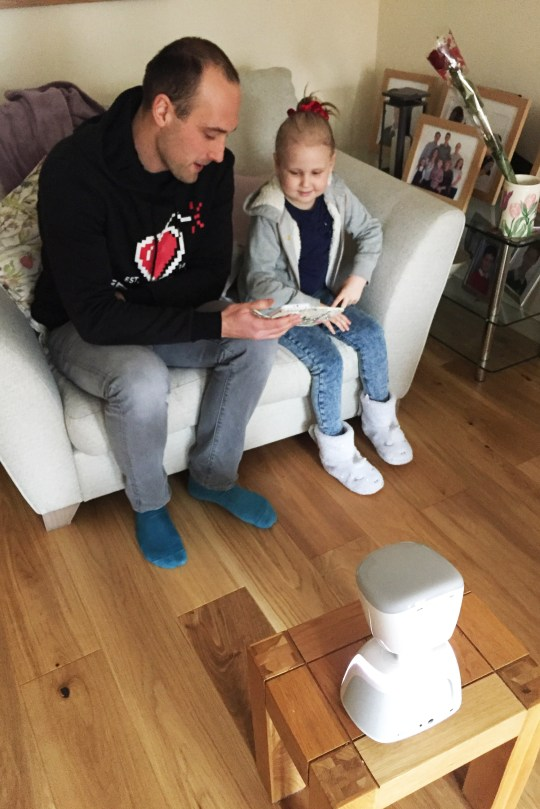 Seren Mawson using her mini me robot at home