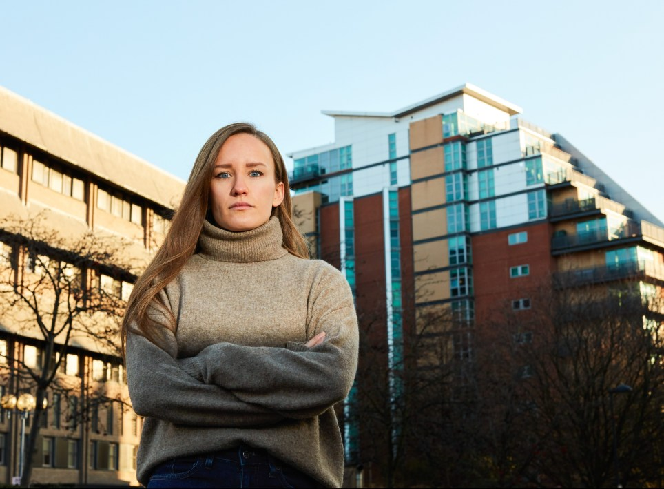Abigail Tubis standing in front of her home in St George's Building, Leeds