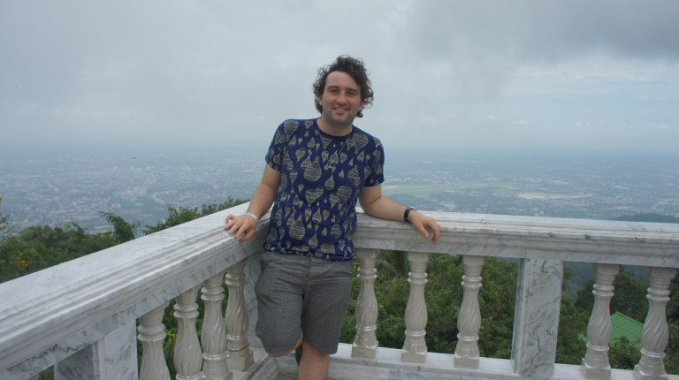 Daniel Hall on a balcony in Thailand