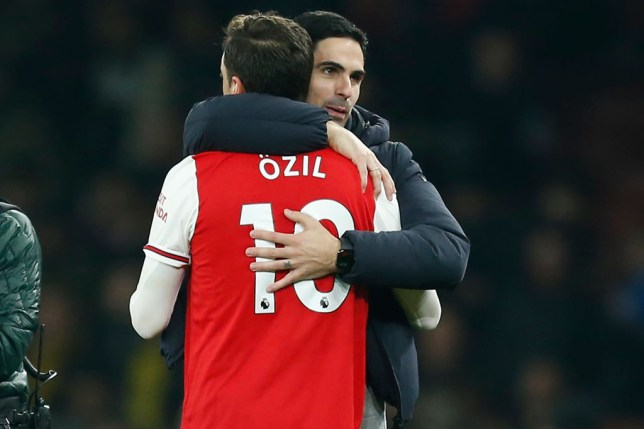 Mesut Ozil and Mikel Arteta embrace after Arsenal's Premier League clash with Manchester United