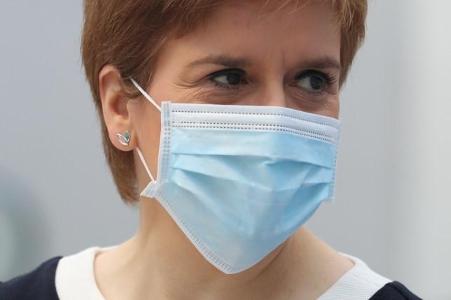 Nicola Sturgeon wearing a face mask.