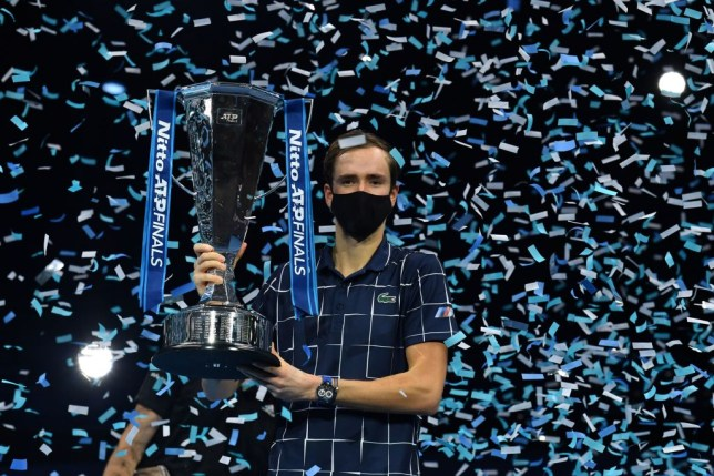 Russia's Daniil Medvedev poses with the winner's trophy after his 4-6, 7-6, 6-4 win over Austria's Dominic Thiem in their men's singles final match on day eight of the ATP World Tour Finals tennis tournament at the O2 Arena in London on November 22, 2020. - Daniil Medvedev came from a set down to beat Dominic Thiem 4-6, 7-6 (7/2), 6-4 and win the ATP Finals title in London on Sunday for the biggest tournament victory of his career.