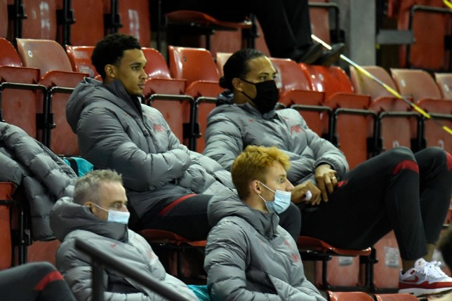 Trent Alexander-Arnold and Virgil van Dijk look on during Liverpool's Carabao Cup clash with Lincoln