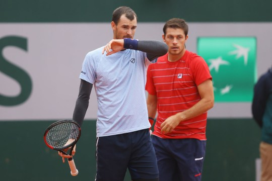 Jamie Murray (L) and Neal Skupski of Great Britain talk tactics in their Men's Doubles first round match against Juan Ignacio Londerp or Argentina and Jiri Vesely of Czech Republic on day three of the 2020 French Open at Roland Garros on September 29, 2020 in Paris, France.