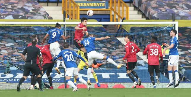 Harry Maguire leaps for a header in Manchester United's win over Everton in the Premier League