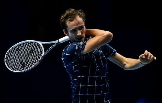 Daniil Medvedev of Russia hits a forehand against Alexander Zverev of Germany during Day 2 of the Nitto ATP World Tour Finals at The O2 Arena on November 16, 2020 in London, England.