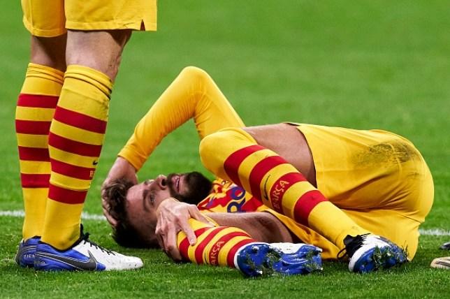 Gerard Pique suffers injury during Barcelona's La Liga defeat to Atletico Madrid
