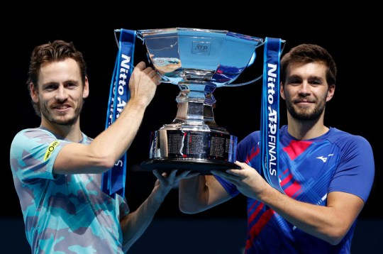 Nikola Mektic of Croatia and partner Wesley Koolhof of Netherlands celebrate with the trophy after winning the doubles final match against Jurgen Melzer of Austria and Edouard Roger-Vasselin of France during day eight of the Nitto ATP World Tour Finals at The O2 Arena on November 22, 2020 in London, England.