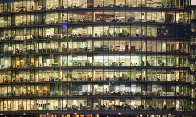 An office block with people working in it late at night.