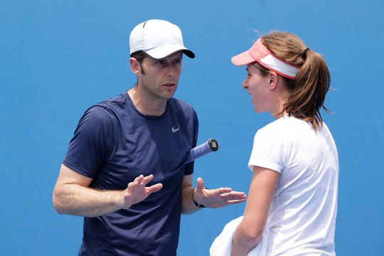 Johanna Konta of Great Britain talks with her coach Esteban Carril in her practice session during day nine of the 2016 Australian Open at Melbourne Park on January 26, 2016 in Melbourne, Australia.
