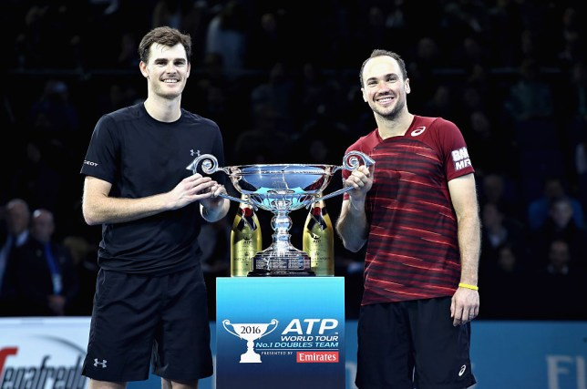 Jamie Murray of Great Britain and Bruno Soares of Brazil celebrate being crownd the Number 1 Men's Doubles Team in the world after their men's doubles semi final against Rajeev Ram of the United States and Raven Klaasen of South Africa on day seven of the ATP World Tour Finals at O2 Arena on November 19, 2016 in London, England.