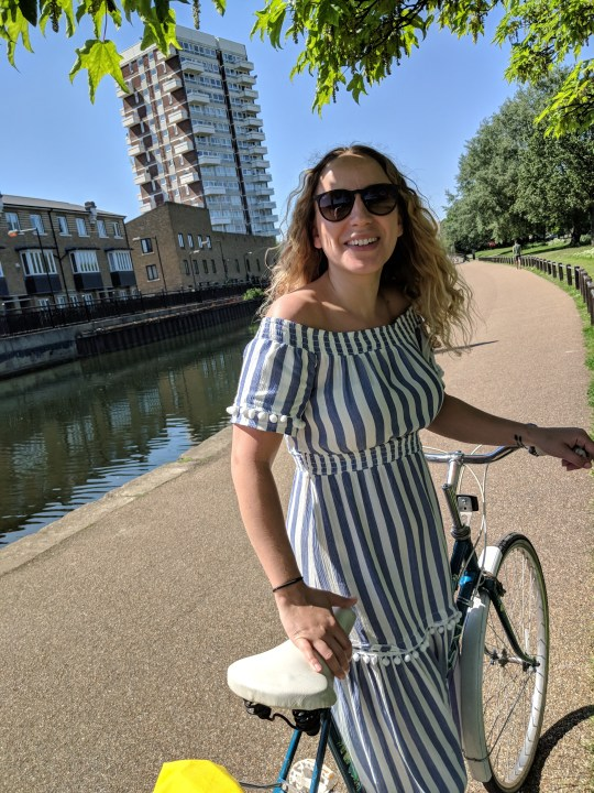Laura Rowe with a bike along a canal