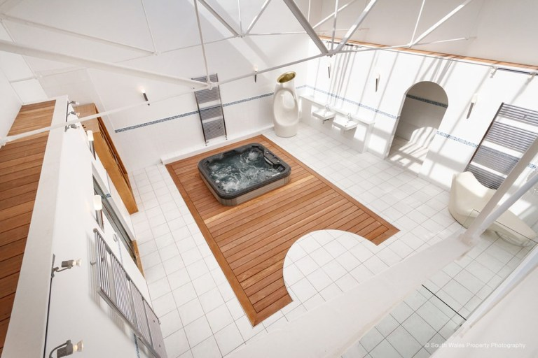 victorian municipal baths apartment on sale - birds eye view of the spae area with a hot tub