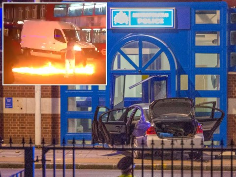 Car deliberately driven into police station before line of petrol is set alight