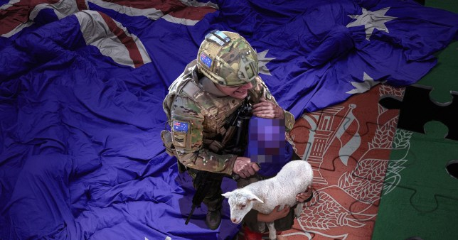 A fake image of an Australian soldier slitting the throat of a child holding a lamb.