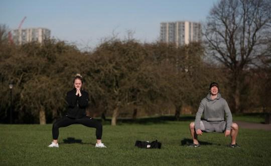 people doing outdoor exercise in regent's park in london