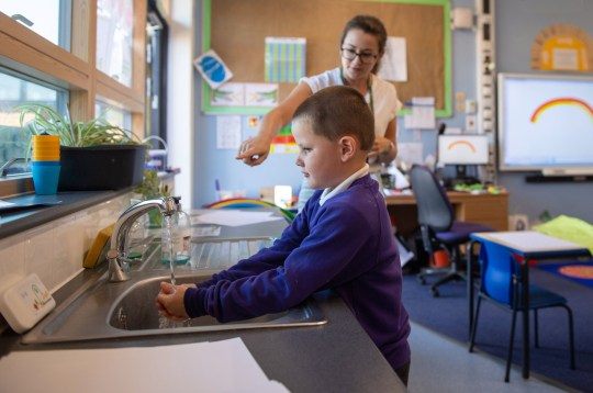 Reception pupil Braydon washes his hands whilst watching an electronic timer at Queen's Hill Primary School, Costessey, Norfolk, as pupils in Reception, Year 1 and Year 6, begin to return to school as part of a wider easing of lockdown measures in England.