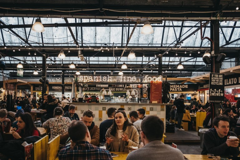 London, UK - January 13, 2019: People at Spanish food stand in Mercato Metropolitano, the first sustainable community market in London focused on revitalising the area and protecting environment.