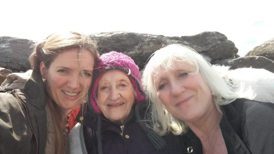Collect from Leandra Ashton, 41 (L), with mum Ylenia Angeli (R) and nan Tina Thornborough (C), in Shetland in summer 2018, copied November 04 2020. See SWNS story SWCAarrest. A retired nurse was arrested today (weds) after she tried to take her dementia-suffering 97-year-old mother from a care home to be looked after by her family. Ylenia D'angeli, aged 73, was detained by officers and taken to Hull Police station after attempting to take her 97-year-old mum who she had not seen for nine months to her home. Last night she was 'de-arrested' and released from custody. Earlier her daughter Leandra Ashton, 42, posted footage of the arrest of her mother - who has not been named - on Facebook.