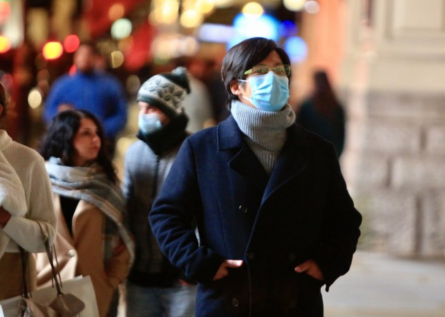 People in face masks in the street