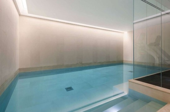 Indoor swimming pool inside church conversion home in fulham