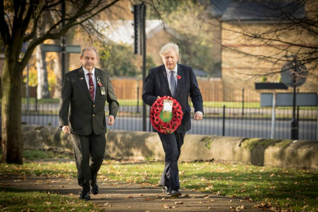 Prime Minister Boris Johnson (right), with Ian Ritchie from Hillingdon and District Royal British Legion, lay a wreath of remembrance at Uxbridge War Memorial in west London, ahead of Remembrance Sunday. PA Photo. Picture date: Saturday November 7, 2020. See PA story MEMORIAL Remembrance. Photo credit should read: Stefan Rousseau/PA Wire