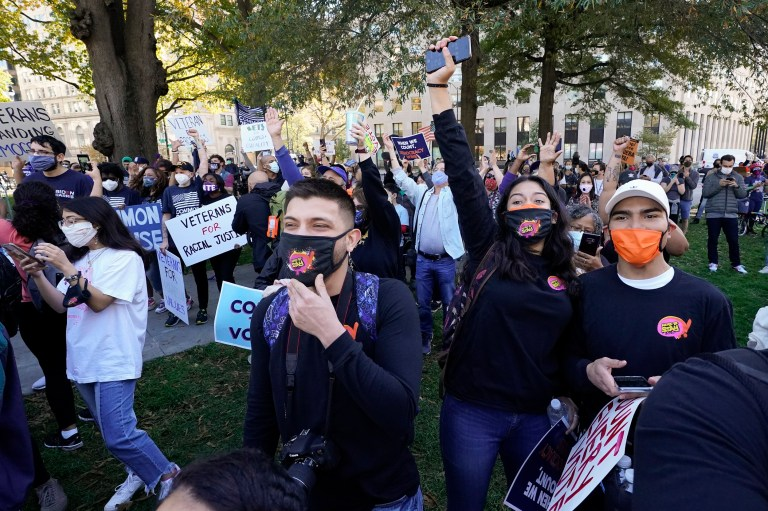 People gathered at Black Lives Matter Plaza celebrate to the announcement that the presidential race had been called in Joe Biden's favor, Saturday, Nov. 7, 2020, in Washington. Democrat Joe Biden has defeated President Donald Trump to become the 46th president of the United States. (AP Photo/Alex Brandon)