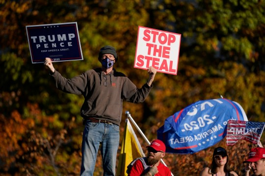 Supporters of President Donald Trump demonstrate outside the Pennsylvania State Capitol