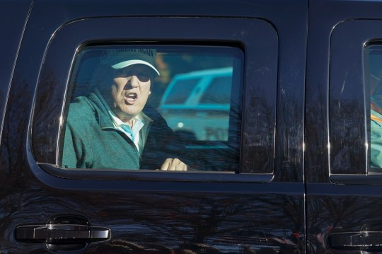 President Donald Trump looks at supporters as he departs after playing golf at the Trump National Golf Club in Sterling Va., Sunday Nov. 8, 2020. (AP Photo/Steve Helber)
