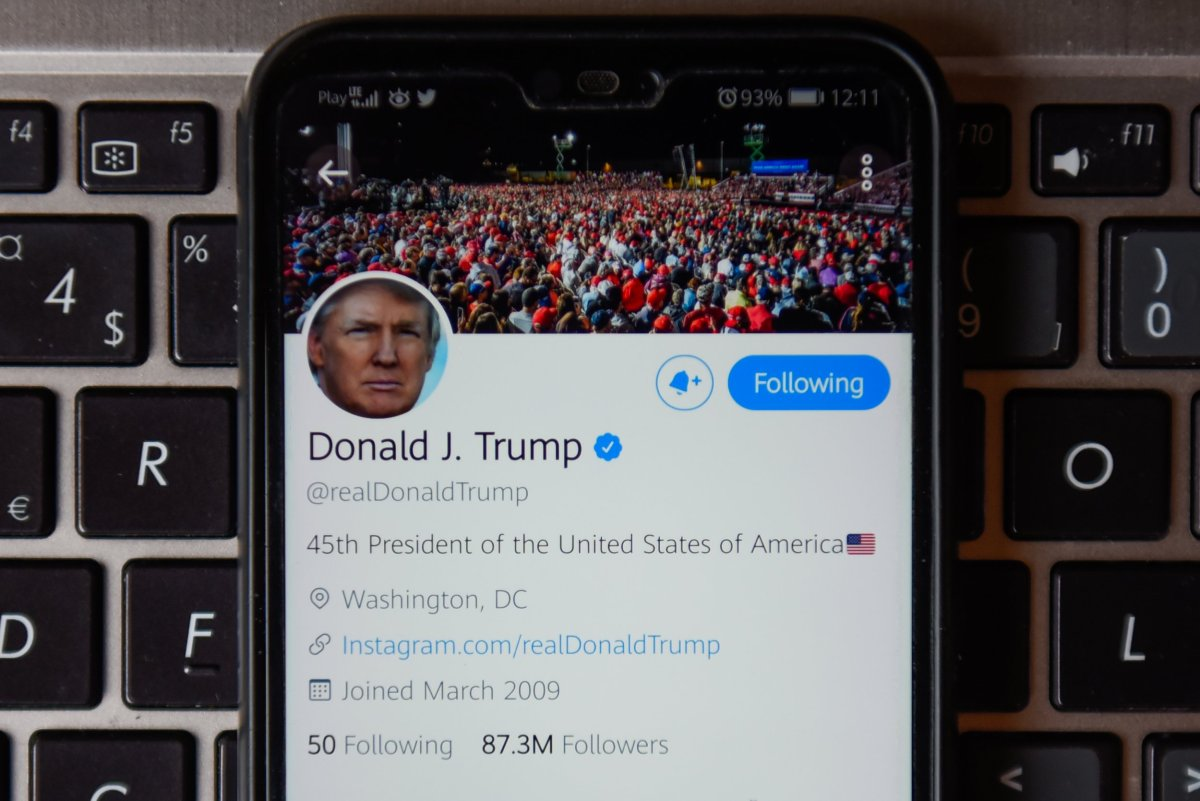 POLAND - 2020/10/21: In this photo illustration a Donald Trump twitter account seen displayed on a smartphone with a laptop keyboard on the background. (Photo Illustration by Omar Marques/SOPA Images/LightRocket via Getty Images)