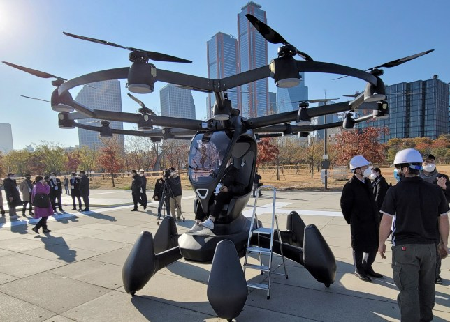 SEOUL, SOUTH KOREA - NOVEMBER 11, 2020: People attend a presentation of delivery drones and drone taxis at a take-off site by the Hangang River. According to South Korea's Ministry of Transport, the launch of unmanned aerial taxis is planned for 2028. Stanislav Varivoda/TASS (Photo by Stanislav Varivoda\\TASS via Getty Images)