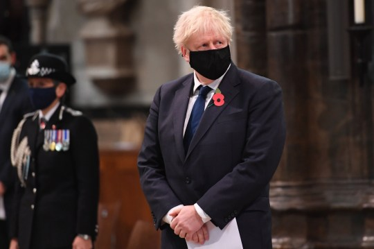Britain's Prime Minister Boris Johnson wearing a face mask participates in a service to commemorate the centenary of the burial of the Unknown warrior at Westminster Abbey on Armistice day in London on November 11, 2020. (Photo by Jeremy Selwyn / POOL / AFP) (Photo by JEREMY SELWYN/POOL/AFP via Getty Images)