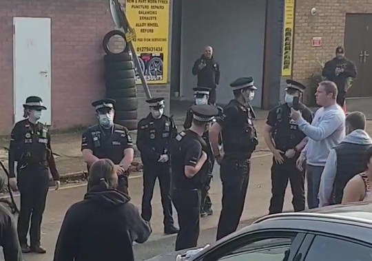 Gym goers were stopped from an outdoor exercise session by a group of five police officers. The group of lycra clad pals were holding a group workout at premises in Harlow, Essex, despite there being a national lockdown. TRIANGLE NEWS 0203 176 5581 // contact@trianglenews.co.uk VIDEO COVIDIOT gym goers were stopped from an outdoor exercise session by a group of five police officers. The group of lycra clad pals were holding a group workout at premises in Harlow despite there being a national lockdown. But someone complained and cops turned up to break up the party on what appears to be an industrial site in the Essex town. Music can be heard blaring from a parked car while men and women stand around in their exercise gear. One woman even continues to lift weights as the police as them to disperse.