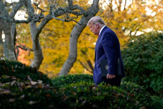 President Donald Trump arrives to speak in the Rose Garden of the White House, Friday,
