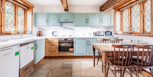 Thatched cottage with tigers as neighbours up for sale - the kitchen and dining area