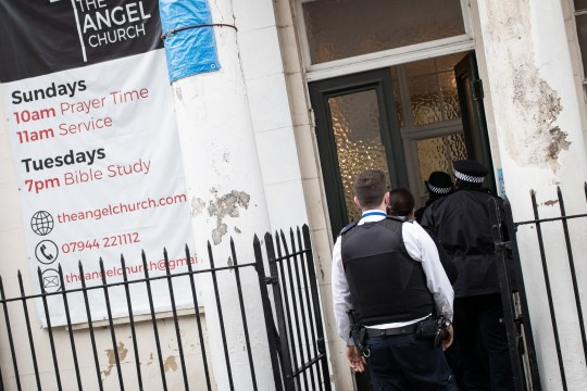 Police officers at the Angel Church in Clerkenwell, London, where they stopped the evangelical church from holding a baptism service, which is in breach of the national coronavirus lockdown restrictions.
