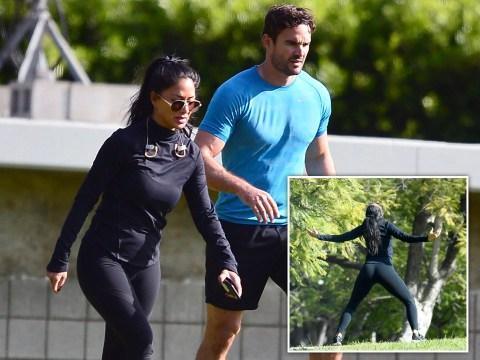 Nicole Scherzinger stretches it out on park date with boyfriend Thom Evans in Los Angeles