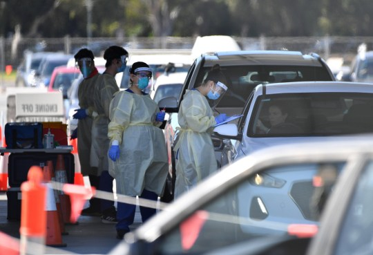 Health authorities are seen testing people in cars at Victoria Park COVID testing centre on November 17, 2020 in Adelaide, Australia.