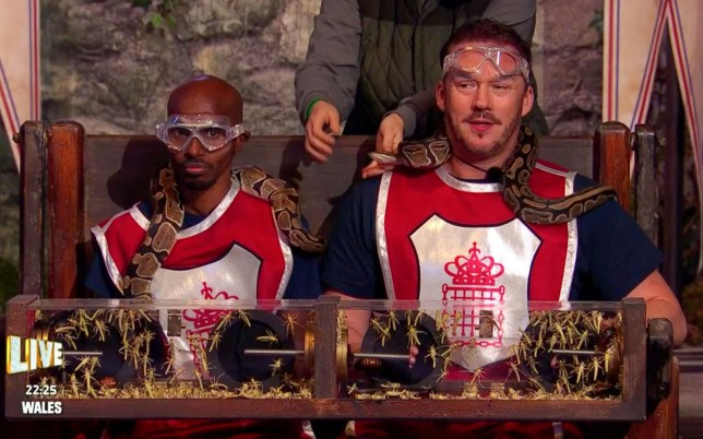 Sir Mo Farah and Russell Watson with snakes around their neck