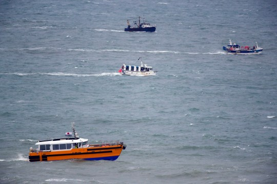 Boats continues their search for the missing two fishermen that went missing near Seaford, Sussex, after their fishing boat, Joanna C, sank off the coast near Seaford, East Sussex on Saturday.