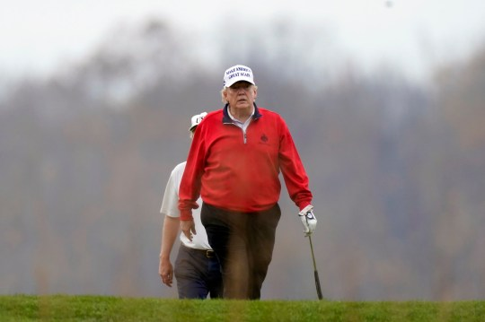 President Donald Trump plays golf at Trump National Golf Club in Sterling, Va., Saturday, Nov. 21, 2020. (AP Photo/Manuel Balce Ceneta)