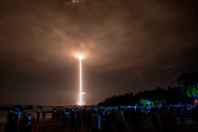 TOPSHOT - A Long March 5 rocket carrying China's Chang'e-5 lunar probe launches from the Wenchang Space Center on China's southern Hainan Island on November 24, 2020, on a mission to bring back lunar rocks, the first attempt by any nation to retrieve samples from the moon in four decades. (Photo by STR / AFP) / China OUT (Photo by STR/AFP via Getty Images)