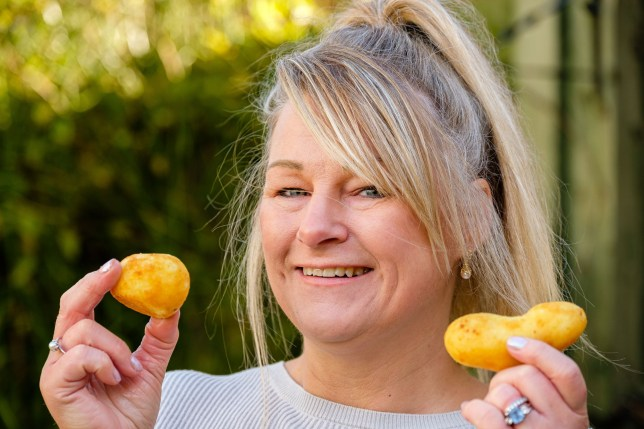 Mandy Camish-Bailey, 51, holding up potatoes