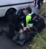 Police officer repeatedly punches HS2 protester who is already restrained