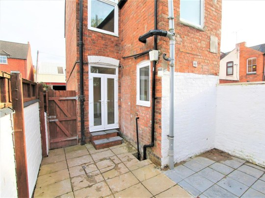 13ft wide home renovated and now on sale. Goldhill Road, in Knighton, Leicester - the patio back garden